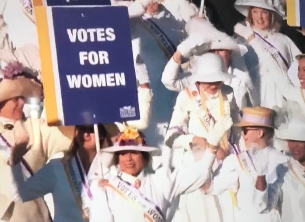 Suffragists in costume marching in the Tournament of Roses Parade 2020