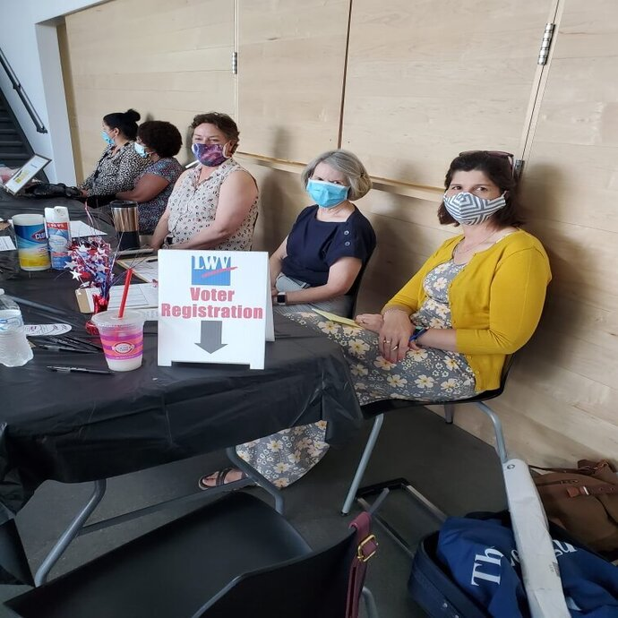 Registering Voters with masks on